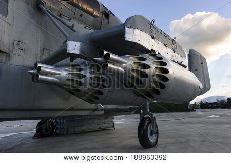 Missile launcher of heavy military helicopter ready to attack, modern army, aviation and aerospace industry, blue sky and white clouds on background
