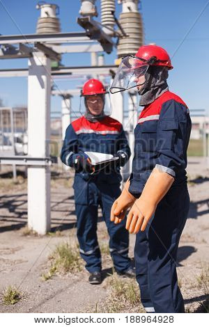 The Duty Electrician Of Substation Makes Switchings