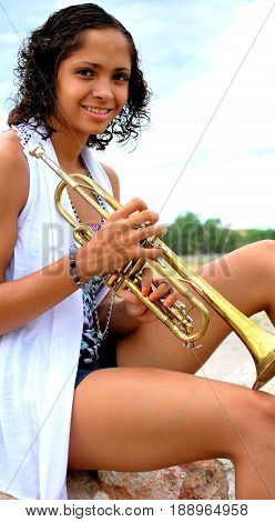African american female beauty expressions outside with her trumpet.
