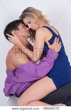 The super sexy couple is in a loving embrace.