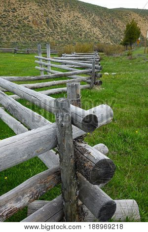 Rustic, wooden, crooked-rail fence in Idaho's Sawtooth mountains near Stanley.