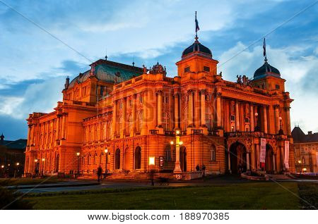 Zagreb, Croatia. Illuminated croatian National Theater in Zagreb at night with cloudy blue sky