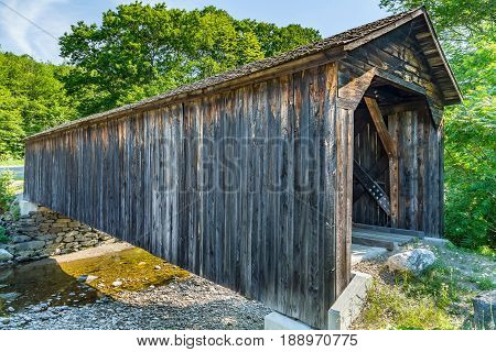 The Cold River Bridge also known as McDermott Bridge is a historic wooden covered bridge over the Cold River in Langdon New Hampshire. 81 feet long it was originally built in 1869 at a cost of $450.