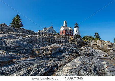 The Pemaquid Point Light is a historic U.S. lighthouse located in Bristol-Lincoln County Maine at the tip of the Pemaquid Neck. The lighthouse was commissioned in 1827 by President John Quincy Adams and built that year.