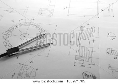 Dividers and part blueprints on engineer's workplace