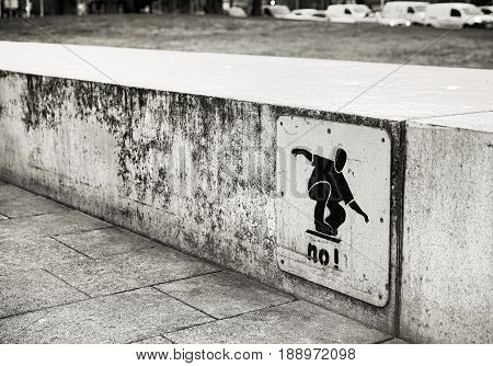 Skateboard ban on a wall in downtown Rostock