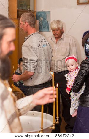 Krasnodar Russia - May 31 2017 - The rite of baptism in the Orthodox Church infant baptism