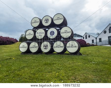 GLENLIVET SCOTLAND - 13 MAY 2017 - Clever use of whisky barrels as signs outside the Glenlivet Distillery where their range of single malt whiskies are made.