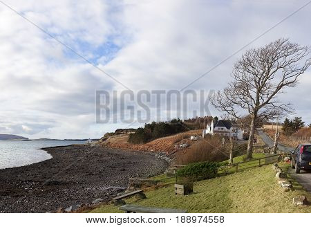 ISLE OF SKY-FEBRUARY 16 2014: Coast of Waternish Village in Scotland in a sunny day on February 16, 2014