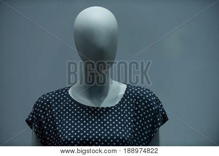 Dummy Imitating Faceless Woman In Fashion Blouse