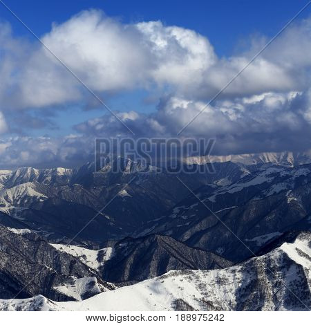 Sunlit Winter Mountains In Clouds, View From Off-piste Slope