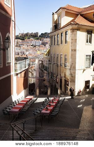 LISBONl-NOVEMBER 3 2016: A waiter waits in front of the restaurant tables to offer tourists their menu in Portugal, Lisbon on November 3, 2016