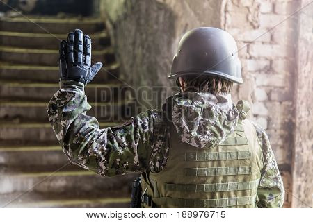 A Soldier With A Gun Assaults The Building. Military Actions And Assault Of Buildings