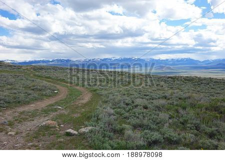 Dirt road in sagebrush foothills of Mt. Borah, looking across Lost River Valley to Idaho's Pioneer Mouintains.