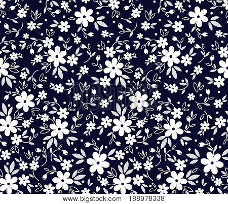 Vector seamless pattern. Cute pattern in small flower. Small white flowers. Navy Blue background. Ditsy floral background. The elegant the template for fashion prints.