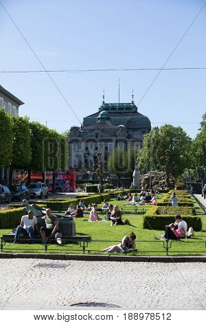 Bergen, Norway - May 27, 2017: The Inhabitants Of Bergen Enjoy The Sun In Parks And Places. Such Day