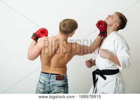 Boxer Punching Young Karate Athlete