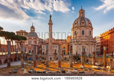 Ancient ruins of Trajan Forum, Trajan Column and churches Santa Maria di Loreto and Most Holy Name of Mary at the Trajan Forum at sunset in Rome, Italy