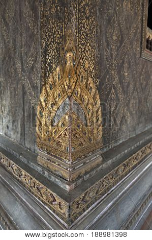 Thai-style Gilded Carved Wooden Ornaments Decorated At Building Corner Inside Ho Trai Or The Library