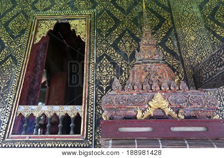 Fully Thai-style Decorated Window And Gilded Wall, With Scripture Box On Carved Wooden Shelf Inside