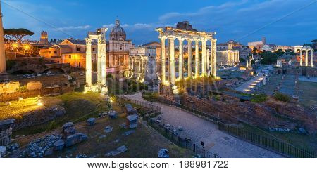 Ancient ruins of a Roman Forum or Foro Romano during evening blue hour in Rome, Italy. Panoramic view from Capitoline Hill