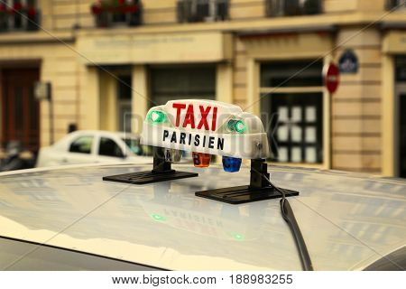 Closeup of taxicab sign in Paris, France