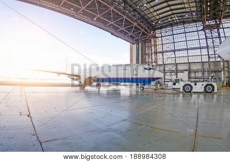 Roll-out of the aircraft from the hangar by a tractor, after repair