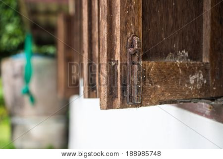 The closeup Wooden open window home latch