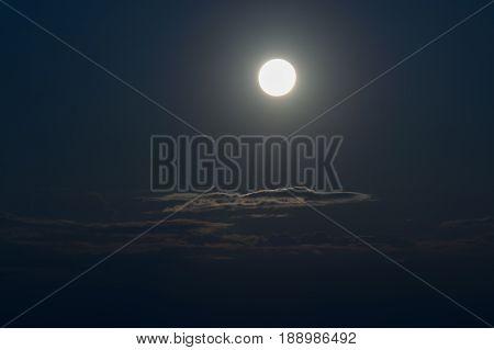 Moon over moonlit clouds in night sky sikkim India