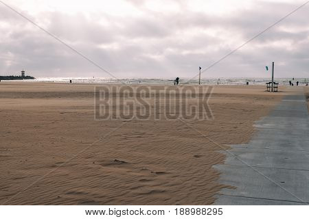 Windy day in the beach of The Hague with kite surfers on background