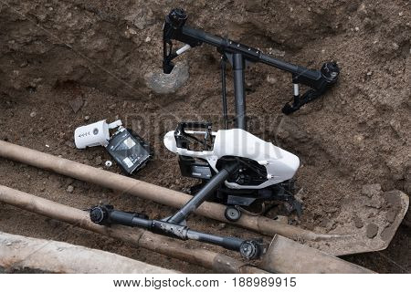 Moscow, Russia - May 28, 2017: Crashed DJI Inspire quadcopter on the construction sitel