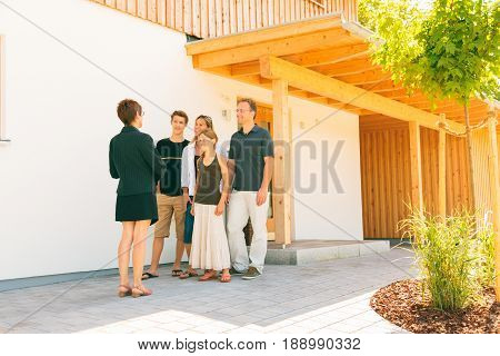 realtor showing a family of four a house