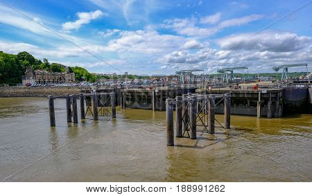Cardiff Bay Wales - May 21 2017: Barrage and locks view from the sea on bright blue sky day.