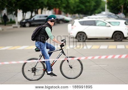 Orel Russia - May 28 2017: Bikeday. Bicyclist riding alone stop tape on street