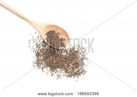Caraway seeds on wooden spoon isolated on white background