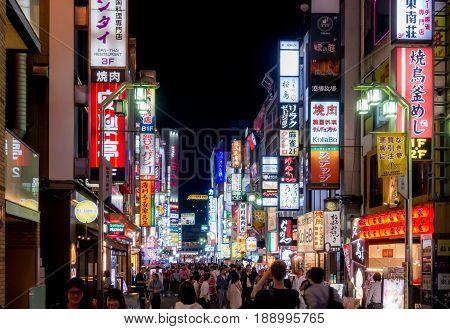 Tokyo Japan - May 5 2017: Advertising signages lighten up at night in Shinjuku street.