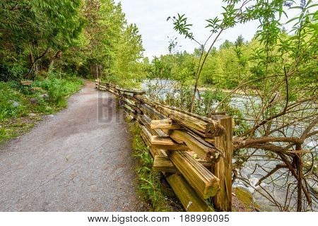 Beautiful Mountain River Trail at the Capilano Park. North Vancouver, British Columbia, Canada.