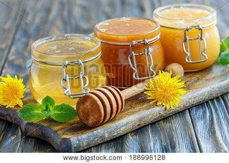 Natural Honey In Glass Jars.