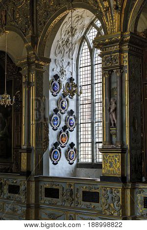 HILLEROD, DENMARK - JUNE 30, 2016: The noble coats of arms decorate a window hole of the palace church of the Frederiksborg Castle.