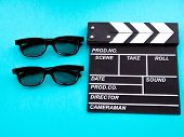 Movie clapperboard on blue background footage background poster