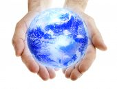 Glowing blue earth in male hands on white background poster
