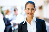 Successful young business woman with charming confident smile poster