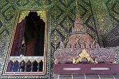 Fully Thai-style decorated window and gilded wall with scripture box on carved wooden shelf inside Ho Trai or the library of Tripitaka (Pali Canon) located at Wat Mahathat Temple in downtown Yasothon northeastern (Isan) province of Thailand poster
