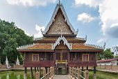 Ho Trai - Traditional Thai-style building used as a library that houses Buddhist scriptures (Tripitaka or Pali Canon) located at Wat Mahathat Temple in downtown Yasothon northeastern (Isan) province of Thailand poster