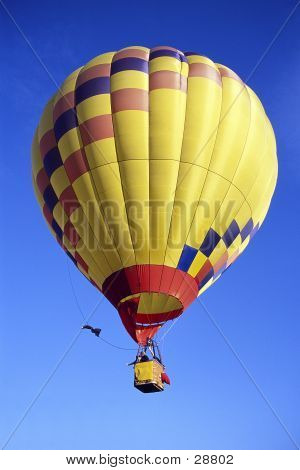 Bright Yellow Hot air baloon rising into the sky poster