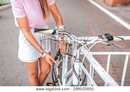 Girl Locks With Cipher Bike Parking Lot. Concept Of Protecting Property From Thieves, Selection Ciph