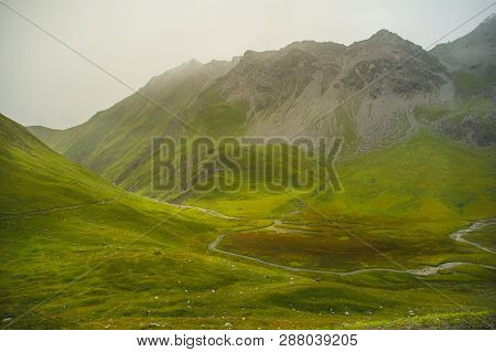 Soft Light Of The Sun Hits A Green High Plateau In The German Alps High Moore In The German Alps Wit
