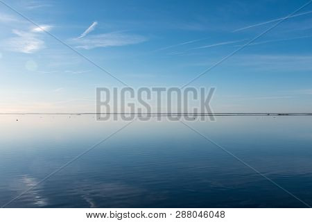 Water Calm Like A Mirror By The Coast Of The Swedish Island Oland In The Baltic Sea