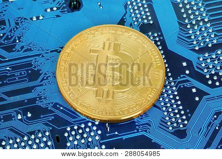 Bitcoin Cryptocurrency Coin On Circuit Board Background Close-up