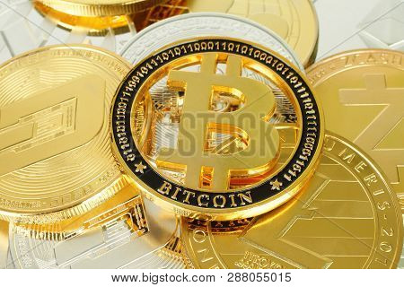 Bitcoin Cryptocurrency Coin On Other Cryptocurrency Coins Background Close-up